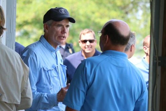 Senator Rob Portman, R-Ohio, speaks with Ottawa County Commissioner Mark Coppeler during a roundtable on lake issues in 2018.