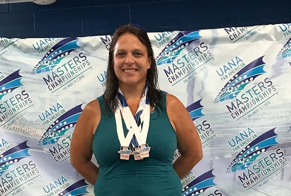 Marysville swim coach Julie Rogers placed in the top 10 of four swim events at the Pan American Games.