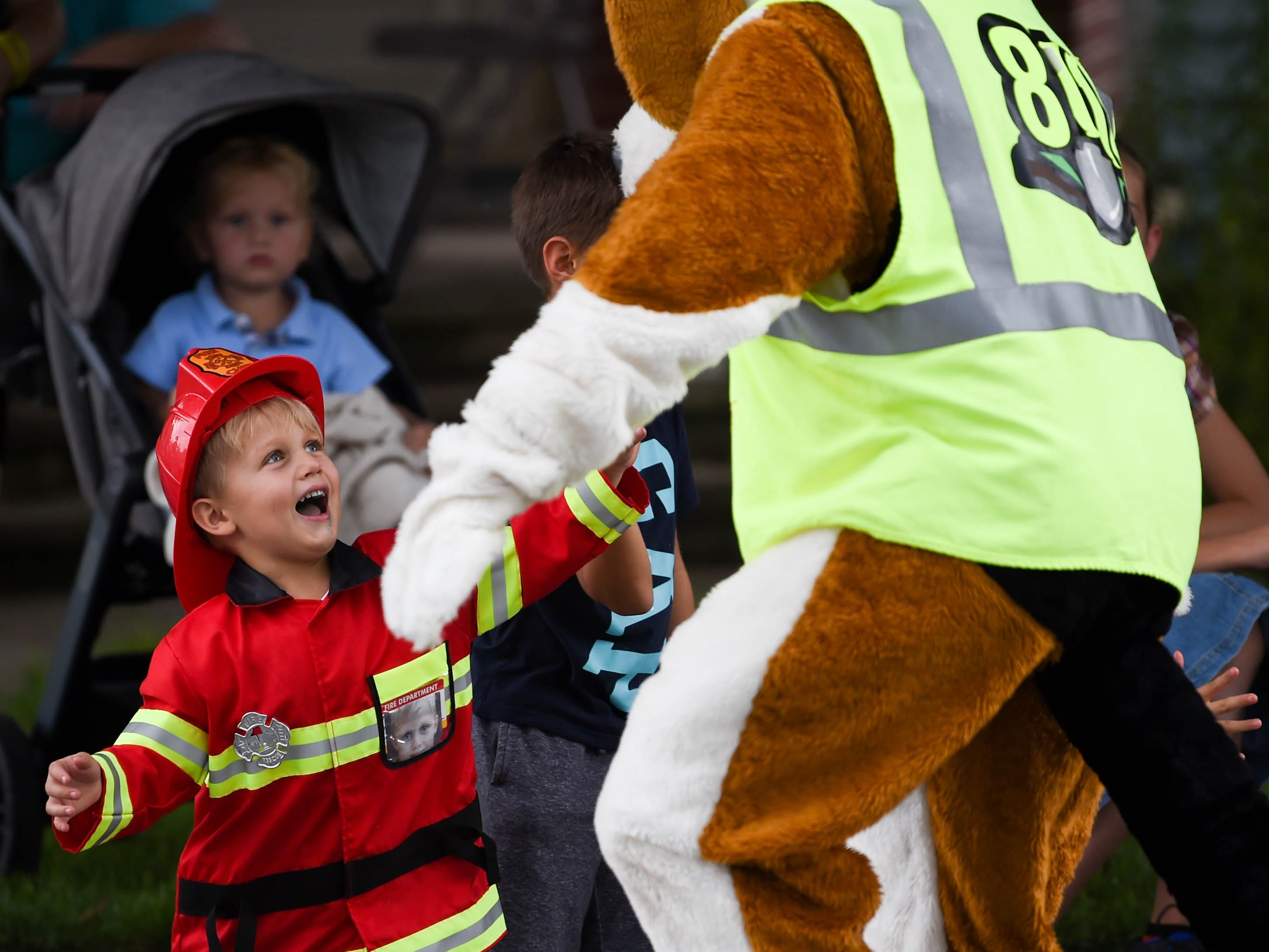 Manuel Golotin, 3, hugs Digger Dog during the York County Fireman's Parade, celebrating Alert Fire Company's 100th year, Saturday, August 18, 2018.