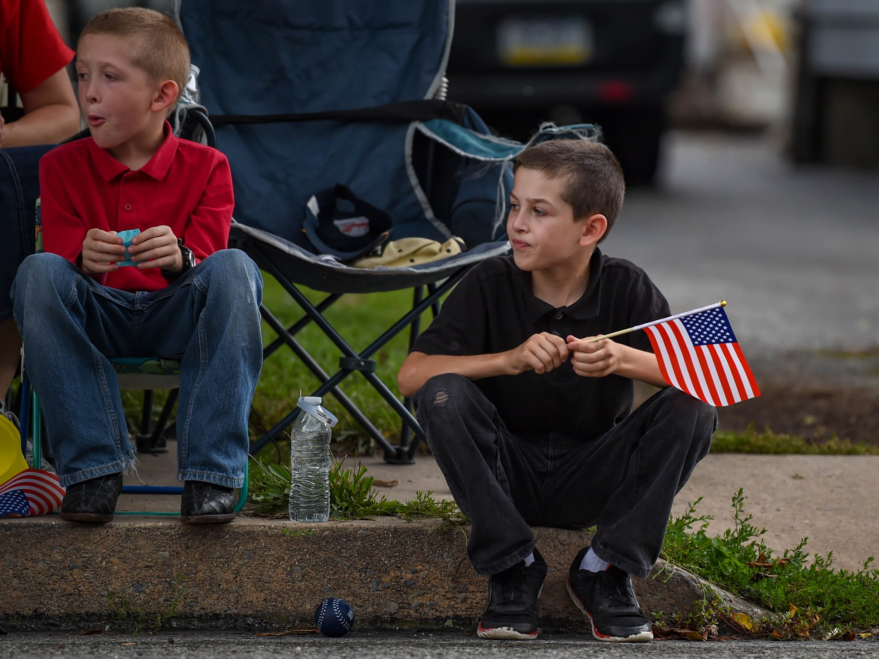 Young parade goers eagerly wait to see what's next during the York County Fireman's Parade, celebrating Alert Fire Company's 100th year, Saturday, August 18, 2018.