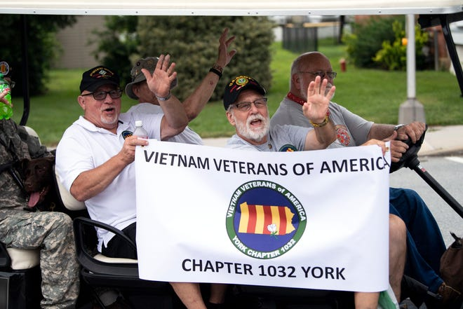 Veterans with the York chapter of Vietnam Veterans of America wave during the York County Fireman's Parade on Aug. 18. A meeting is set for Jan. 17 about organizing a Williamson County chapter of VVA.