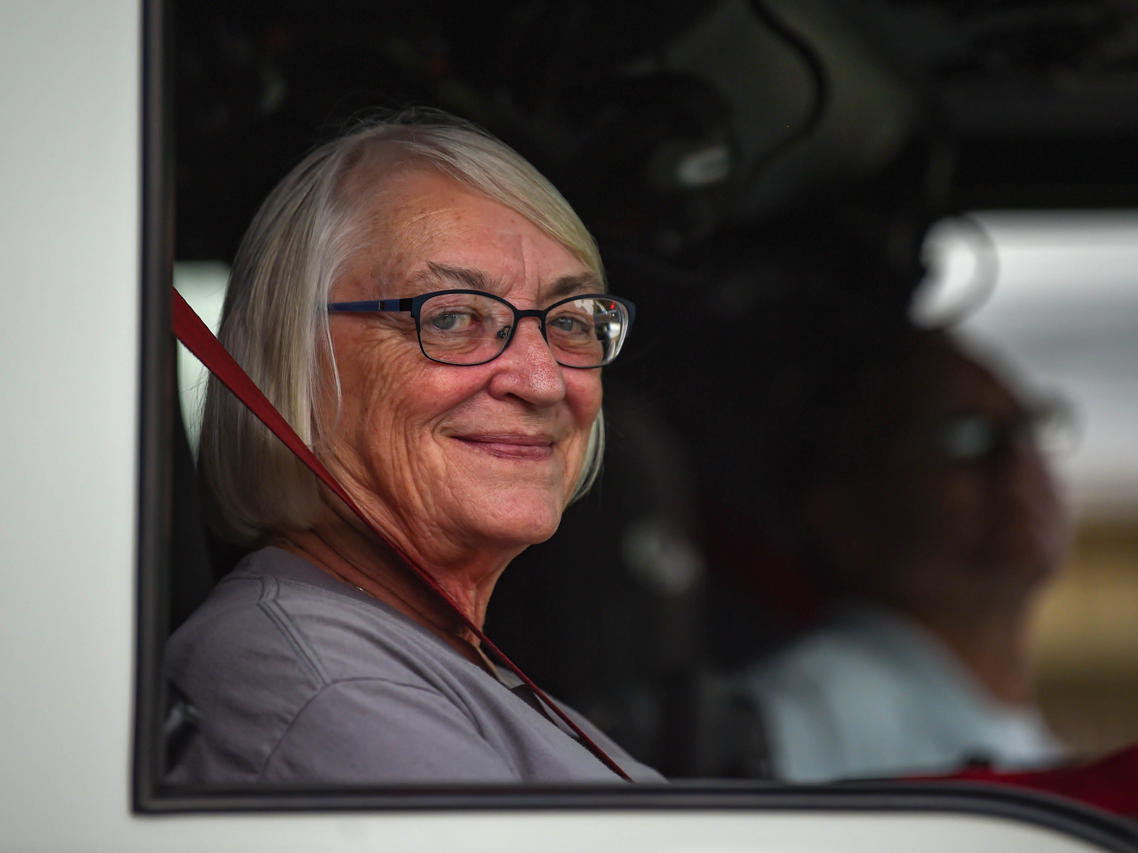 A Woman is all smiles during the York County Fireman's Parade, celebrating Alert Fire Company's 100th year, Saturday, August 18, 2018.