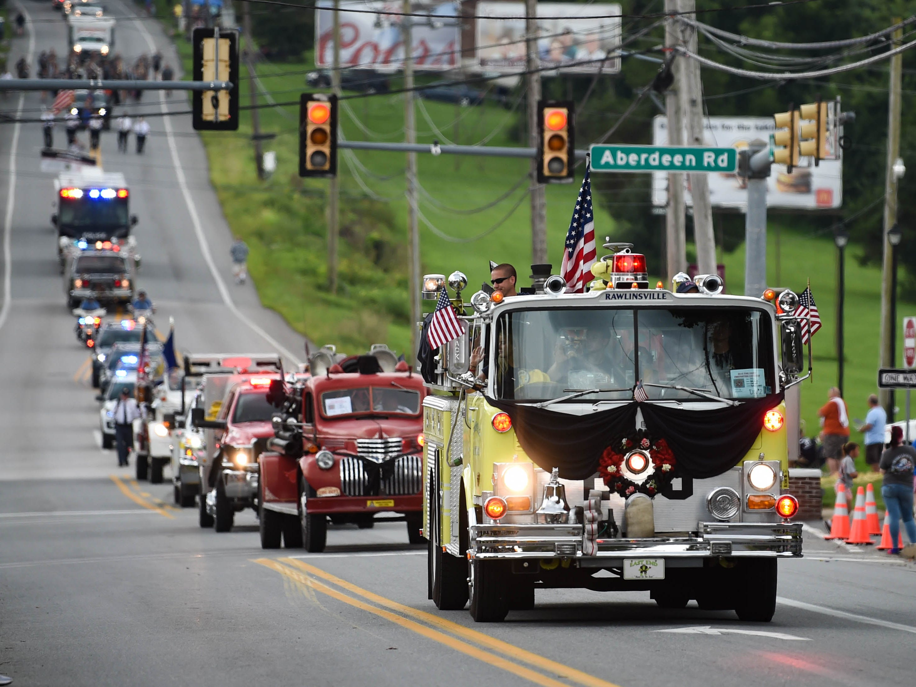 Dozens of vehicles follow each other closely during the York County Fireman's Parade, celebrating Alert Fire Company's 100th year, Saturday, August 18, 2018.