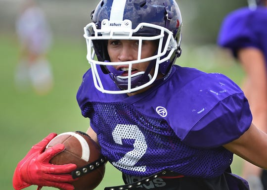 Spanish Springs' Colby Melton runs with the ball during practice on the school practice field on August 15.