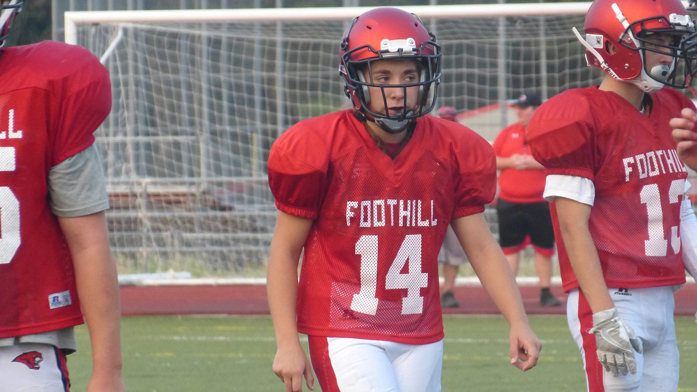 Lilia Hoheisel lines up at linebacker for Foothill. Football teams for Foothill, Shasta and Enterprise High gathered at Foothill on Friday for a three-way scrimmage. The field was split at the 50-yard line, and teams alternated offensive and defensive series.