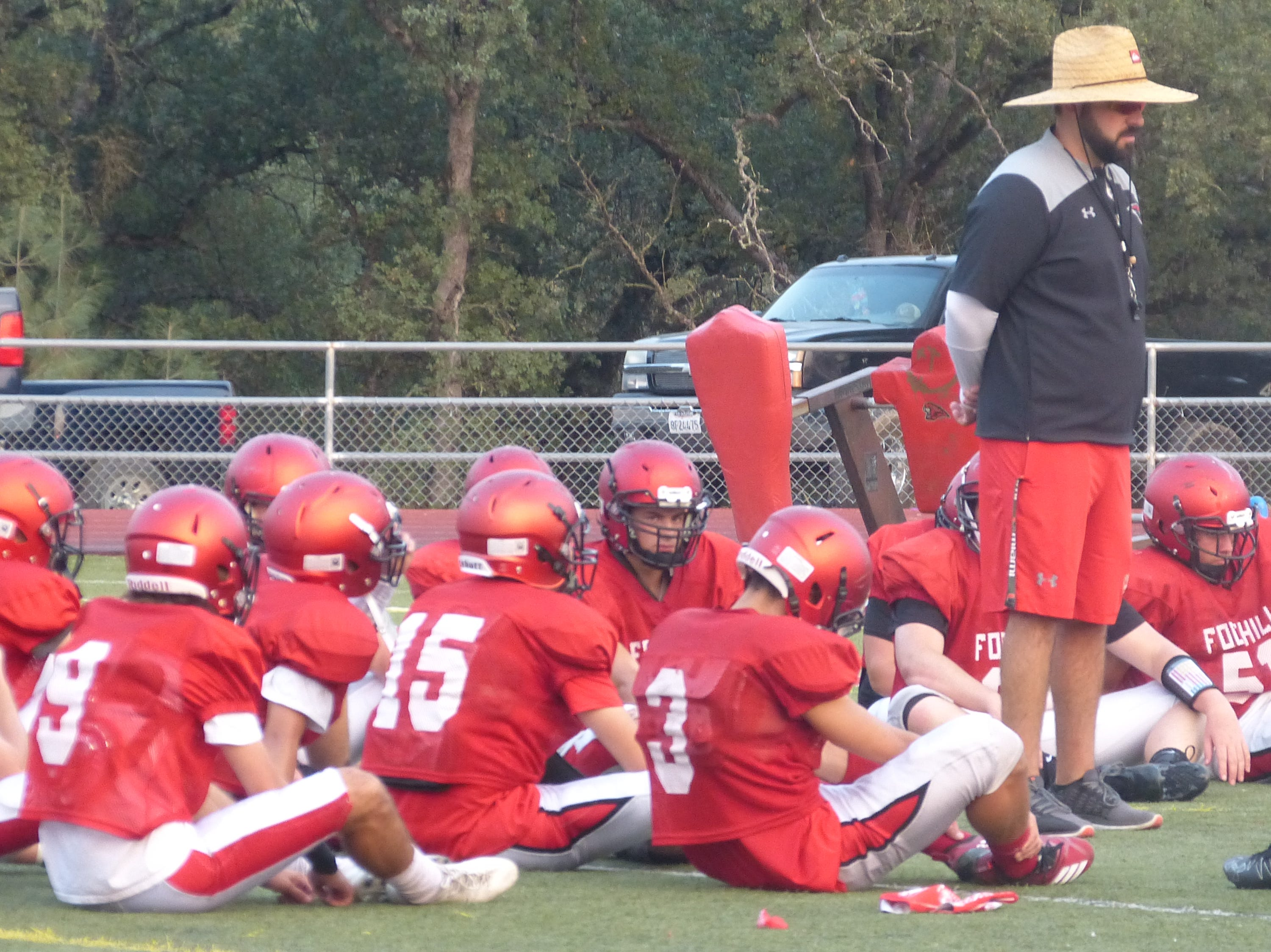 Foothill coach Joey Brown talks with his team after a preseason scrimmage.