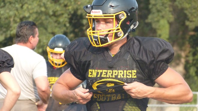 Enterprise quarterback Leslie Cummings looks on during a scrimmage against Foothill and Shasta on Friday, Aug. 17.