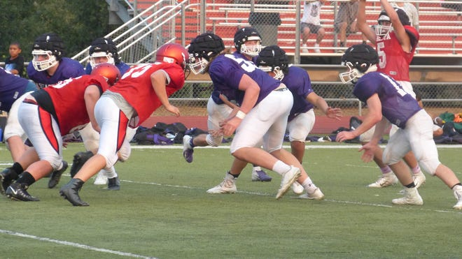Football teams for Foothill, Shasta and Enterprise High gathered at Foothill on Friday for a three-way scrimmage. The field was split at the 50-yard line, and teams alternated offensive and defensive series.