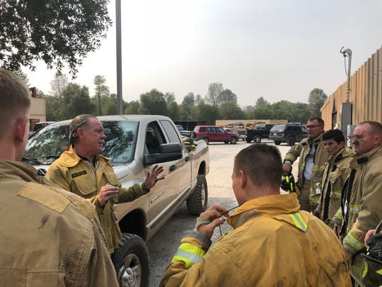 "Bill Masten (center, leaning on truck) says students at Shasta College's Fire Technology program need to understand ""you cannot beat Mother Nature."" Masten worked as a firefighter for 30 years in Los Angeles County."