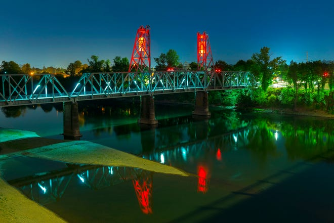 A Salem bridge is turned orange to remind travelers to watch for road workers.