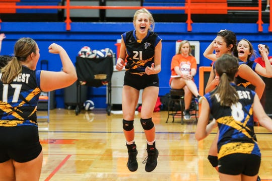 Veribest's Kameron Salvato jumps in the air as the team celebrates after a set during the Nita Vannoy Memorial Volleyball Tournament Saturday, Aug. 18, 2018, at Central's Babe Didrikson Gym.