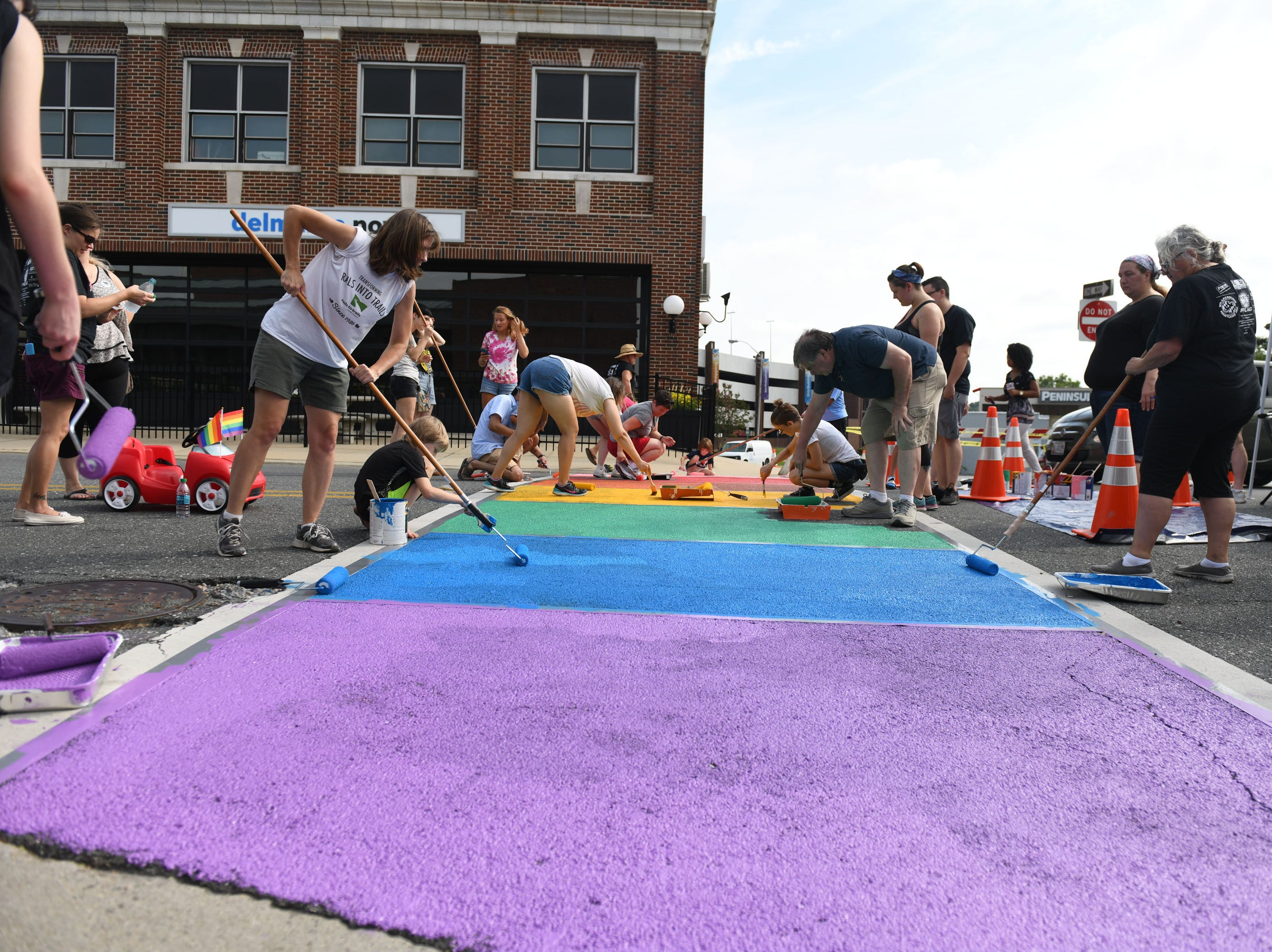 Salisbury PFLAG partnered with the City of Salisbury to paint a semi-permanent rainbow crosswalk in downtown Salisbury on Saturday, August 18, 2018.