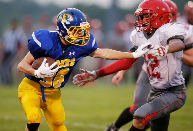 Howards Grove's Kaeden Roethel (30) drives the ball against Manitowoc Lutheran on Friday. Roethel finished with 194 yards on the ground and added a 67-yard punt return for a touchdown.