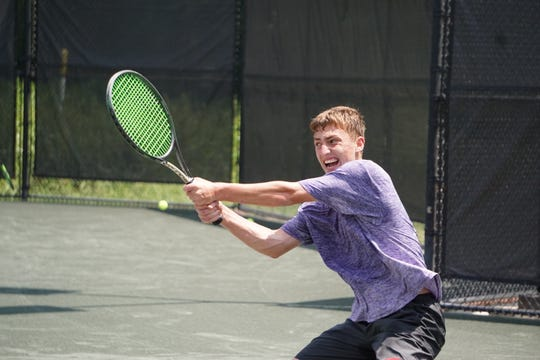 Stafford Jerger plays during the quarterfinals of the City Championships at the Bossier Tennis Center on Saturday.