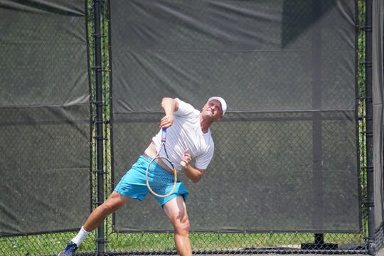 John McGregor serves during the quarterfinals of the City Championships at the Bossier Tennis Center on Saturday.