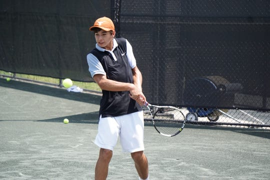 Andrew Otzenberger plays during the quarterfinals of the City Championships at the Bossier Tennis Center on Saturday.