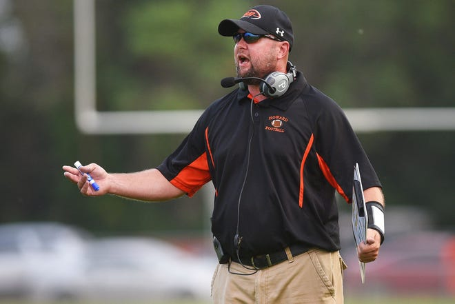 Howard coaches react to a call during the game against Garretson Friday, Aug 17, in Howard.