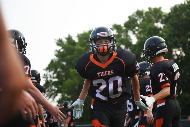Howard's Lane Miller takes the field before the game against Garretson Friday, Aug 17, in Howard.