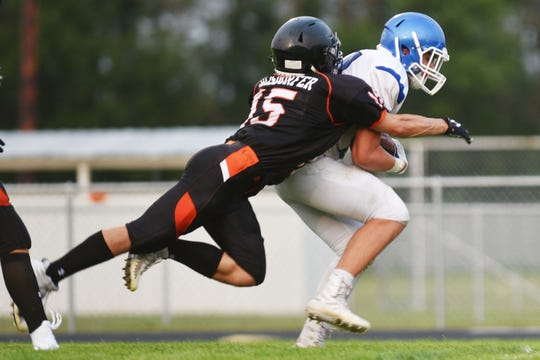 Garreton's Drew Blosmo is tackled by Howard's Gavin Ericksen-Reisdorfer during the game Friday, Aug 17, in Howard.