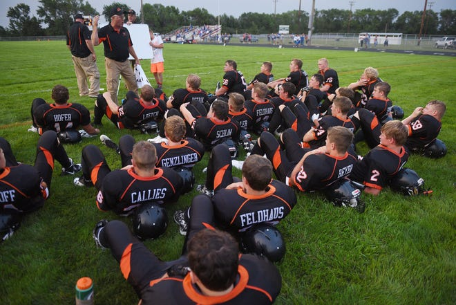 Howard head coach Pat Ruml talks to the team during half time during the game against Garretson Friday, Aug 17, in Howard.