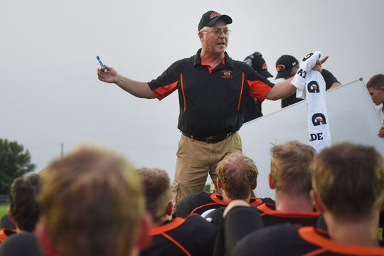 Howard coach Troy Loudenburg talks to the team during half time during the game against Garretson Friday, Aug 17, in Howard.