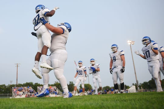Garretson's Isaiah Robinson is lifted up by Dakota Johnson when they take the field before the game against Howard Friday, Aug 17, in Howard.
