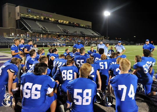 Sioux Falls Christian players listen to their coaches following a victory over Winner on Friday, Aug. 17, in Sioux Falls.