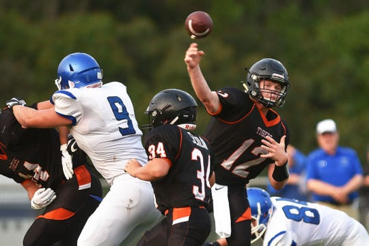 Howard's Isaac Feldhaus throws the ball against Garretson defense during the game Friday, Aug 17, in Howard.