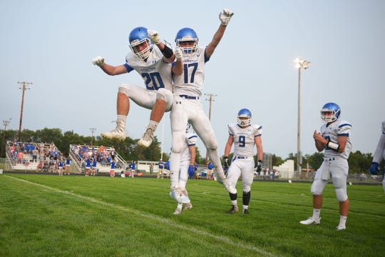 Garretson's Trenton Karli (20) and Cole Skadsen (17) take the field before the game against Howard Friday, Aug 17, in Howard.