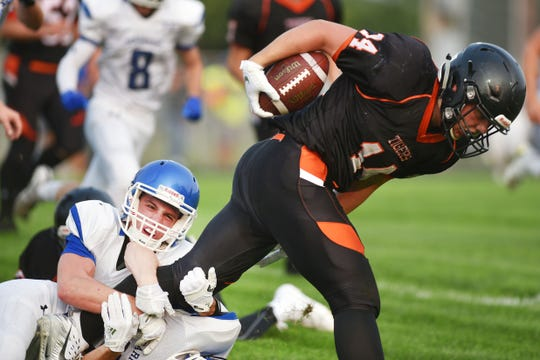 Garretson's Dominic Abraham, left, tackles Howard's Michael Hofer during the game Friday, Aug 17, in Howard.