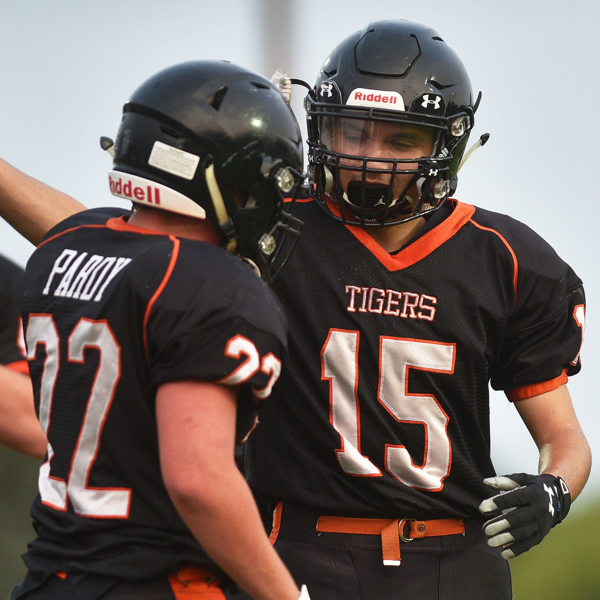 Howard's 	Gavin Ericksen-Reisdorfer (15) celebrates with  Zach Pardy (22) in the end zone during the game against Garretson Friday, Aug 17, in Howard.