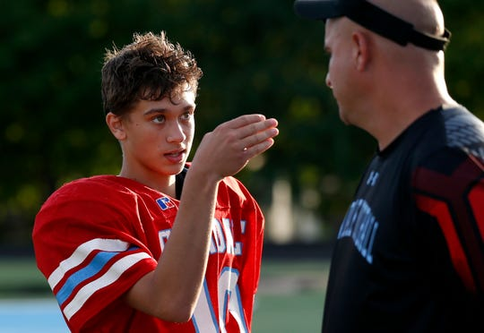 Glendale quarterback Blaine Huston talks to a coach after rotating out of the jamboree game against Marshfield at Glendale on Friday, August 17, 2018
