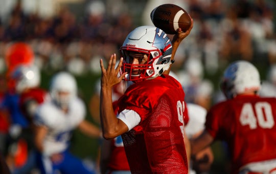 Glendale quarterback David Wells throws a pass during a jamboree game against Marshfield at Glendale on Friday, August 17, 2018