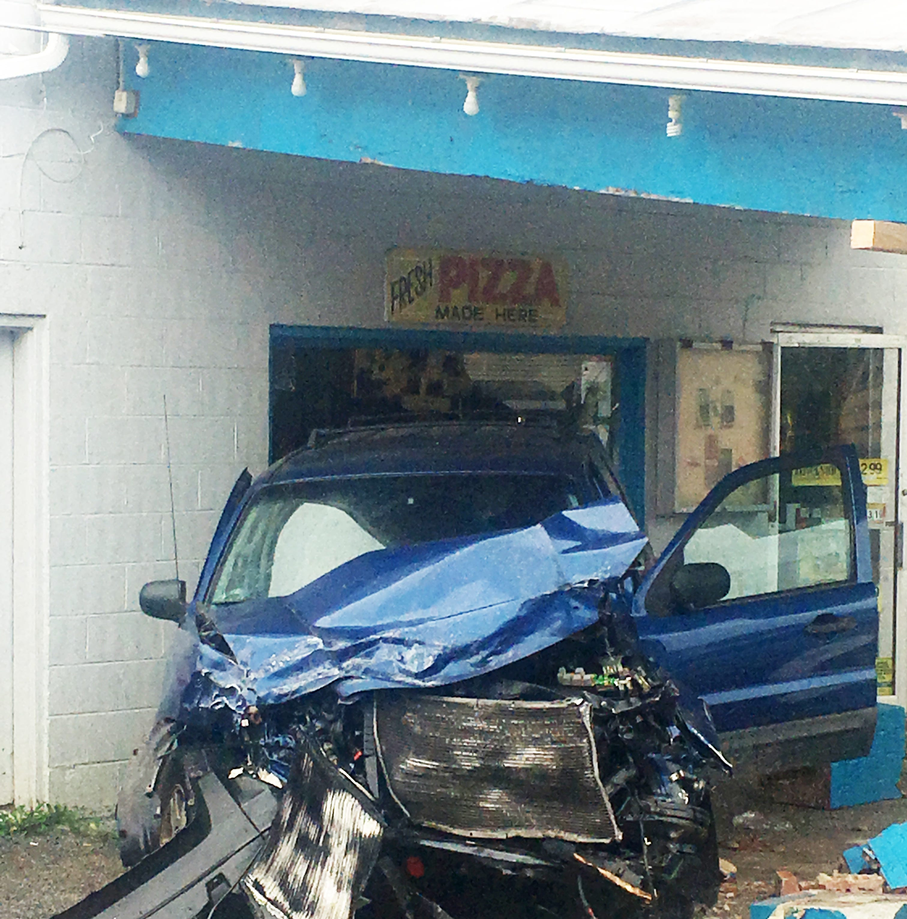 An individual allegedly eluding police caused a two-vehicle crash, damage to New Hope Grocery