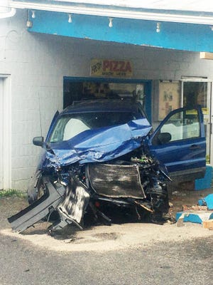 A car struck the New Hope Grocery and another overturned Saturday in the aftermath of a police chase.