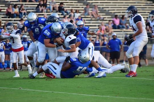 From top left, Robert E. Lee's Brendan Miller, Bam Dobbins and Zay Brown bring down a Harrisonburg ball carrier during the first half of the Leemen's preseason scrimmage against Harrisonburg on Friday, Aug. 17, 2018, at Winston-Wine Memorial Stadium in Staunton, Va.