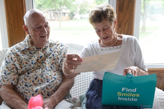 Twins Virgil Egerman and Ginny Egerman Symons look through photos during an interview Saturday, Aug. 18, in St. Cloud.