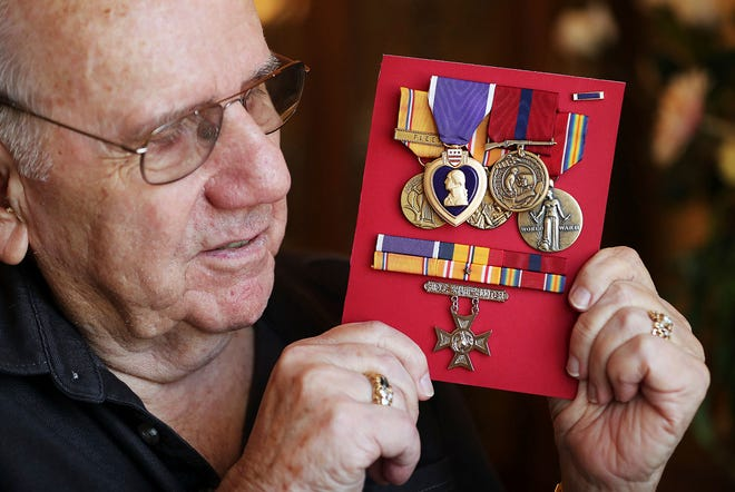 Robert J. Holmes, nephew to Marine Pfc. Robert Kimball Holmes, shows his uncle's medals in Draper on Aug. 16, 2018. Pfc. Holmes, 19, of Salt Lake City was killed during the attack on the USS Oklahoma in 1941 during World War II. The Marine is finally returning to Salt Lake City thanks to a recent DNA match.