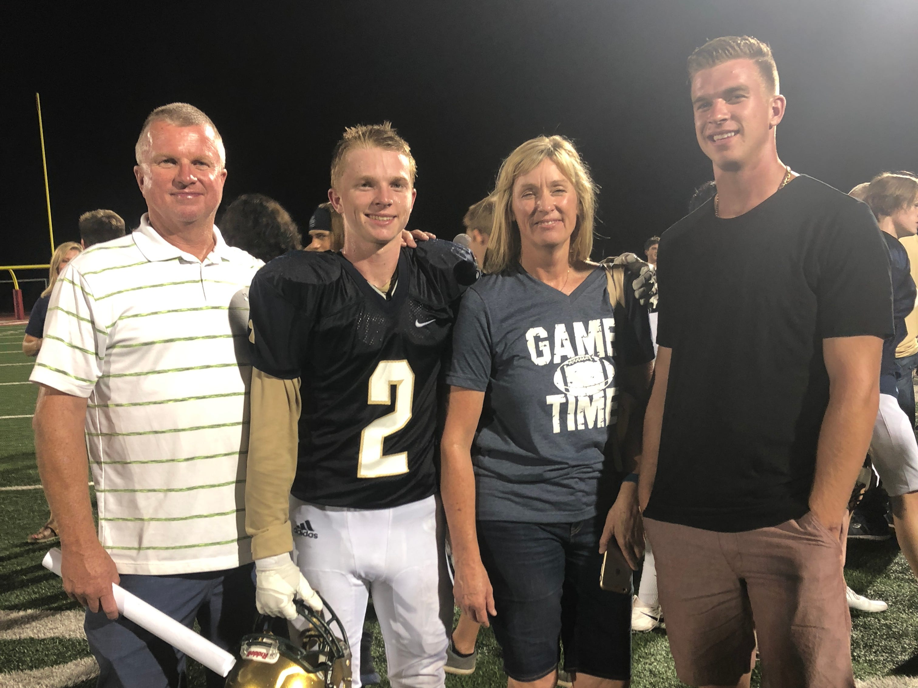 Carson Holyoak with family after scoring the winning touchdown for the Snow Canyon on a 100-yard interception in overtime to give the Warriors a 35-29 victory over Taylorsville