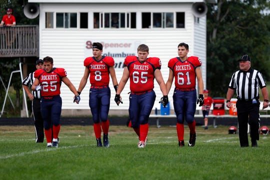 Spencer/Columbus Catholic captains walk onto the field for the coin toss  prior to the opening kickoff in the season opener against Stratford at Ted Fritsch Field on Friday night.