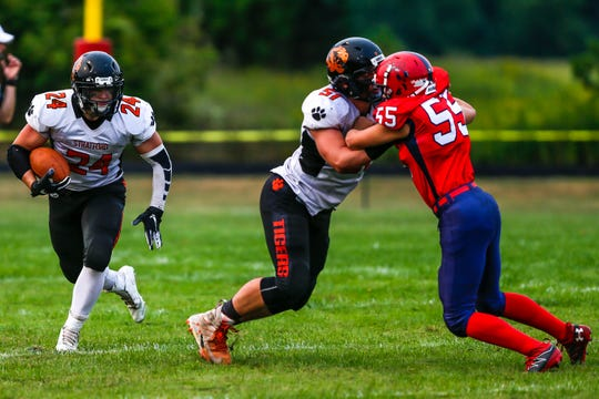Kade Ehrike and the rest of the Stratford running backs found running room tough to find against a stout Spencer/Columbus Catholic defense in the season opener for both teams Friday night.