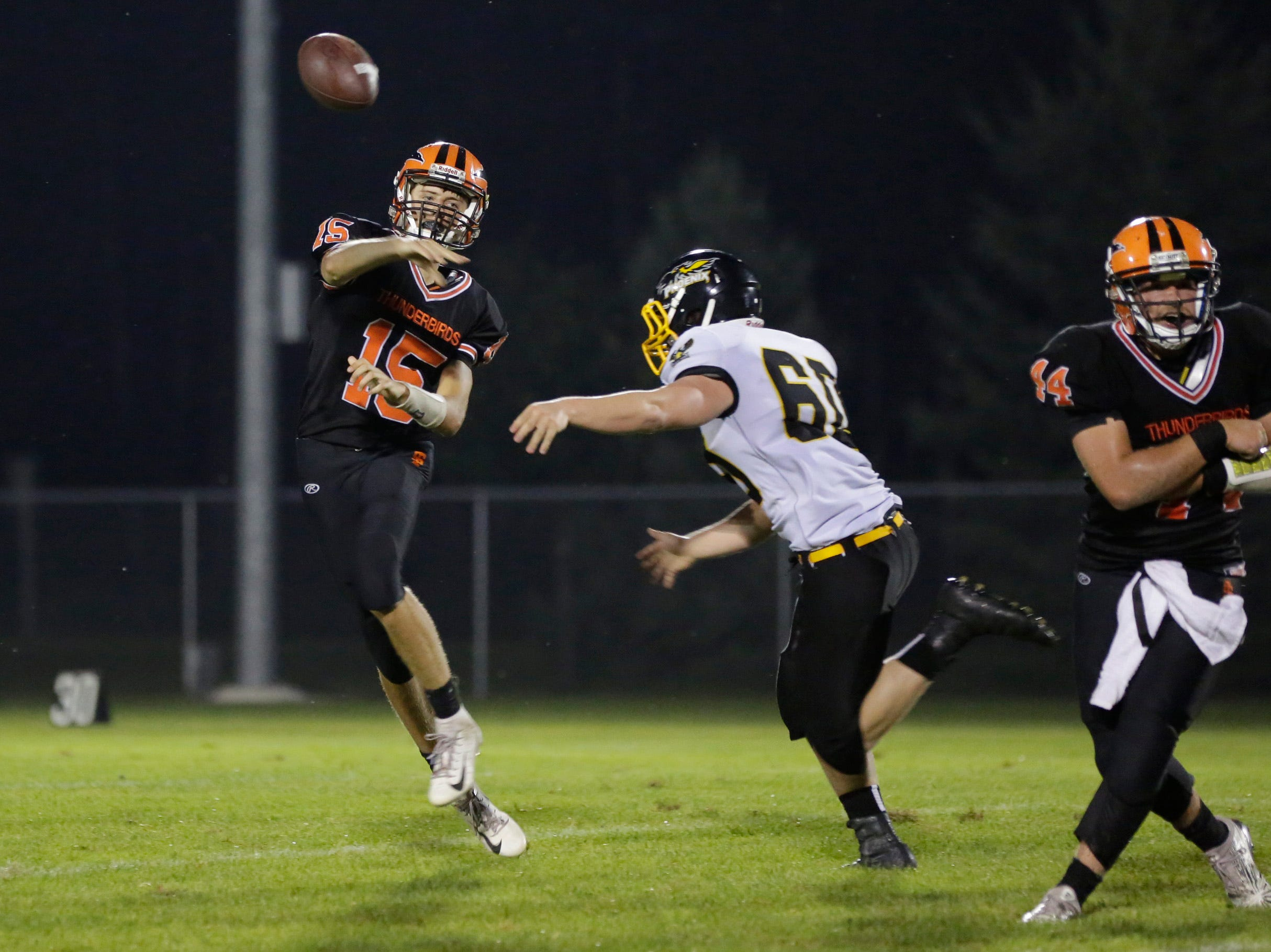 Iola's Connor Kurki (15) throws the ball during the first football game of the season, between Iola-Scandinavia and Montello/Princeton/Green Lake at Thunderbird Field in Scandinavia Friday, August 17, 2018.