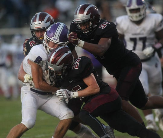 Chiles DB Bryant McKnight makes a tackle as Gainesville plays at Chiles on Friday night in a preseason game.