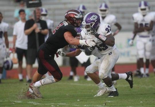 Chiles LB Cameron Richardson makes a tackle as Gainesville plays at Chiles on Friday night in a preseason game.