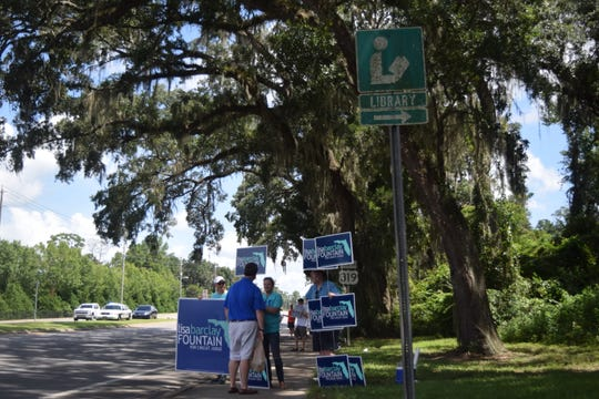 County Commissioner and mayoral candidate John Dailey stops to talk with supporters on Thomasville Road leading to the Northeast Branch Library.