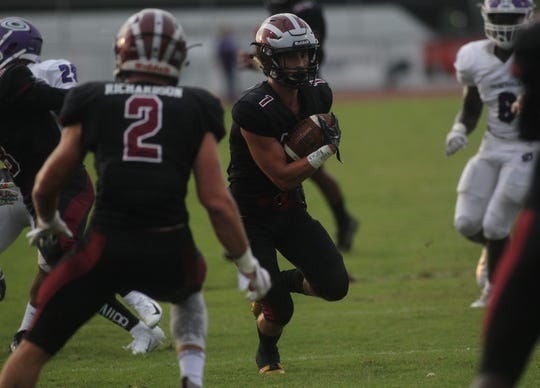 Chiles' Drew Richardson returns a punt for a good gain as Gainesville plays at Chiles on Friday night in a preseason game.