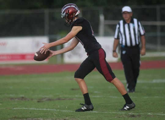 Chiles' Tyler Keltner prepares for a punt as Gainesville plays at Chiles on Friday night in a preseason game.