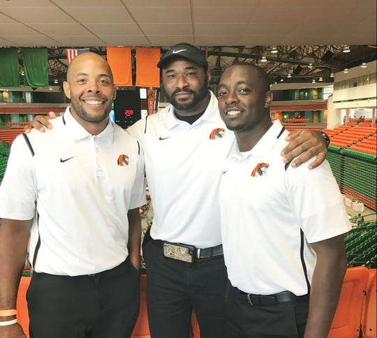 Defensive masterminds Brandon Sharp (left), Ralph Street (center) and Kenneth Gilstrap II (right) share a moment at Fan Day in 2018. Sharp and Gilstrap II oversee the secondary. Street is the defensive coordinator.