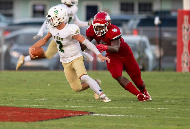 Viera quarterback Bryce Norton is sacked by Vero Beach's Jahfari Harvey (right) during the second quarter of the Kickoff Classic high school football game Friday, Aug. 17, 2018, at the Citrus Bowl at Vero Beach High School.