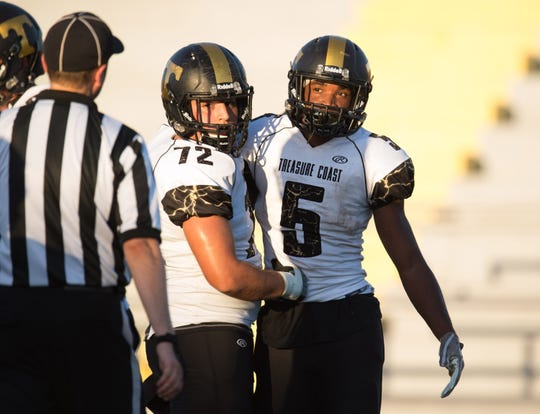 Treasure Coast's Travis Perdomo, left, celebrates with teammate Shamar Minnis after Minnis scored a touchdown against Fort Pierce Westwood in the first half of their preseason game at the Calvin Triplett Field at Lawnwood Park on Friday, August 17, 2018 in Fort Pierce. To see more photos, go to TCPalm.com.
